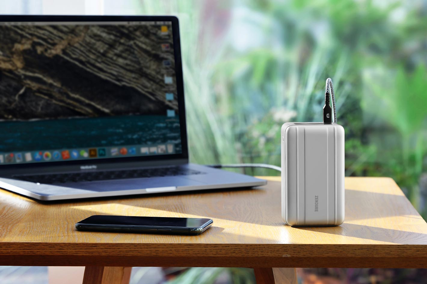 SuperTank Pro can charge two MacBooks and two smartphones at once